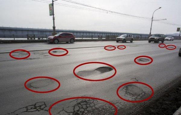 11 ям на 10 метрах: Коммунальный мост в Новосибирске превратился в «поверхность Марса»